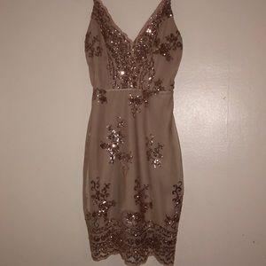 A short sequin rose gold party dress